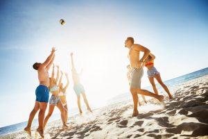 Group friends plays ball beach sea